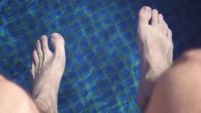 Feet In The Swimming Pool: Stock Video