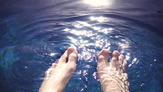 Relaxing Feet In Swimming Pool: Stock Video