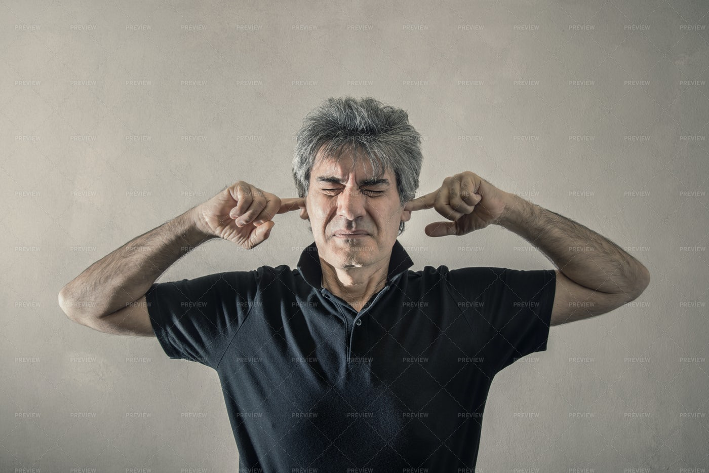Fingers In His Ears: Stock Photos