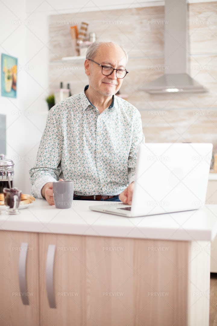 Elderly Man Working On Laptop: Stock Photos