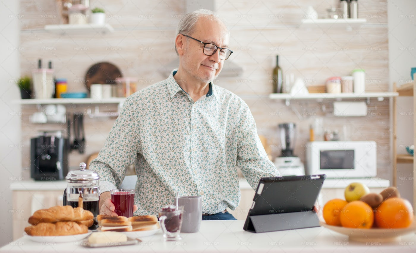 Browsing On Tablet At Breakfast: Stock Photos