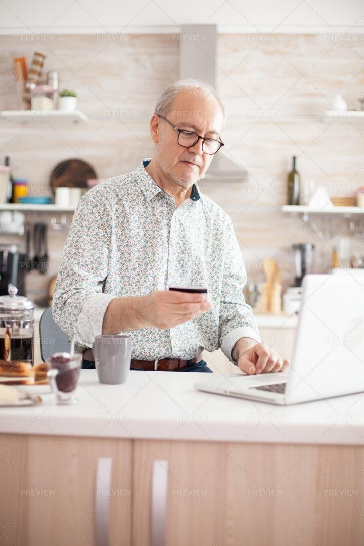 Senior Man Making Online Purchase: Stock Photos