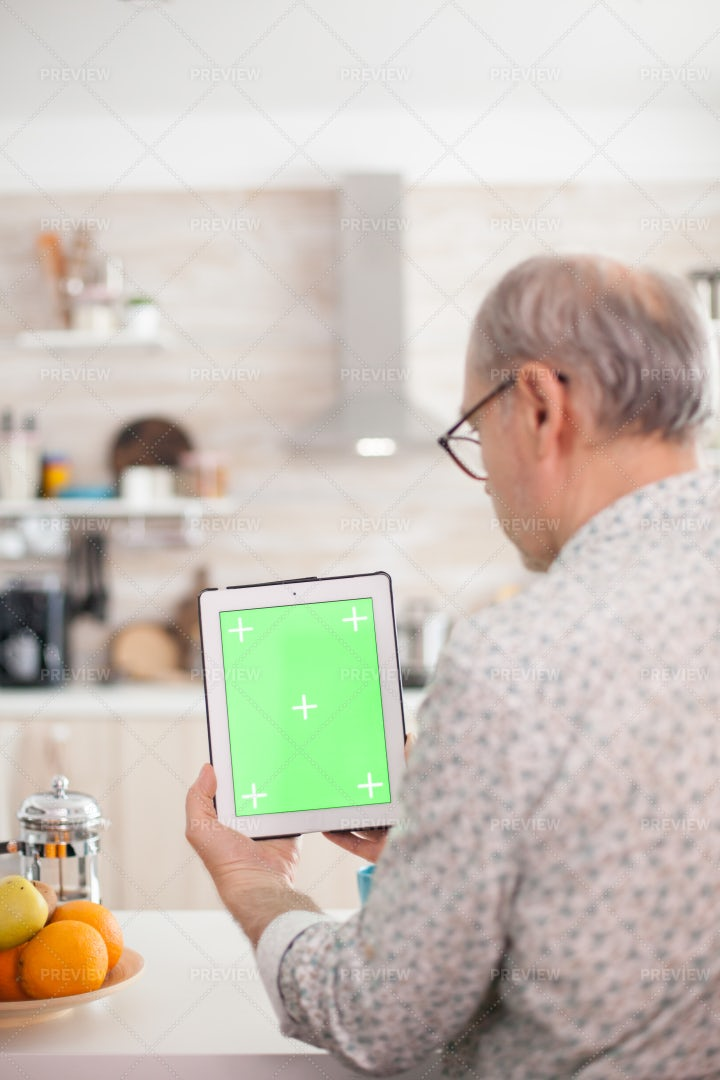 Holding Tablet PC With Chromakey Markers: Stock Photos