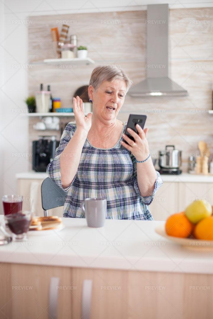 Retired Woman Says Hello On Phone: Stock Photos