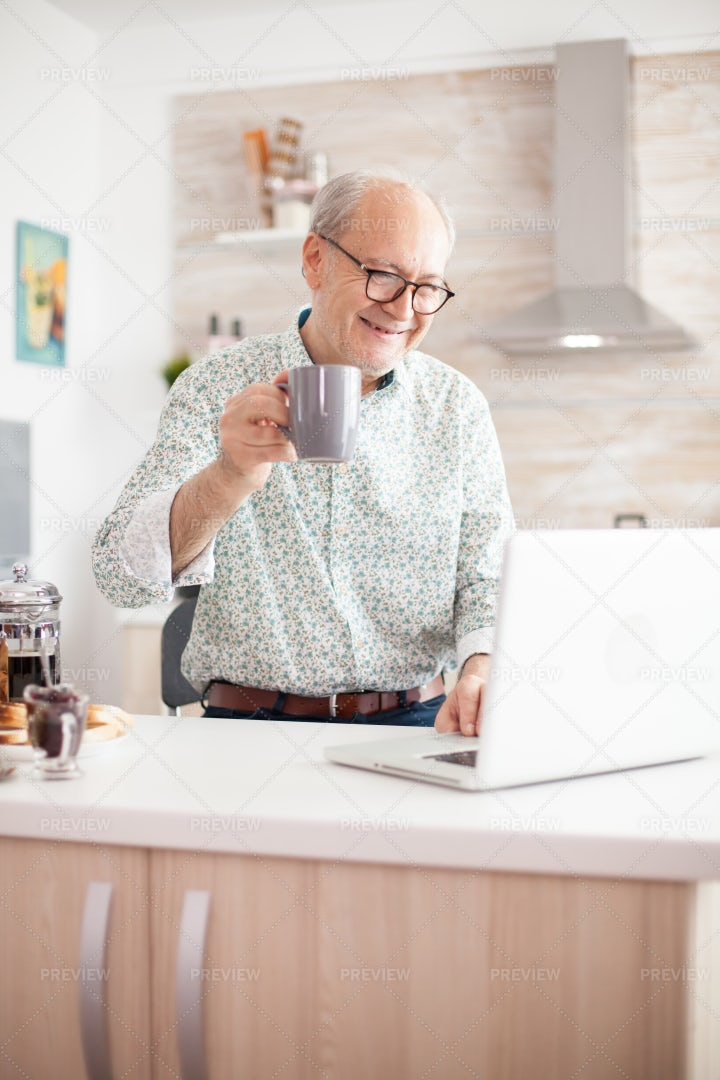Grandfather Video Chat With Family: Stock Photos