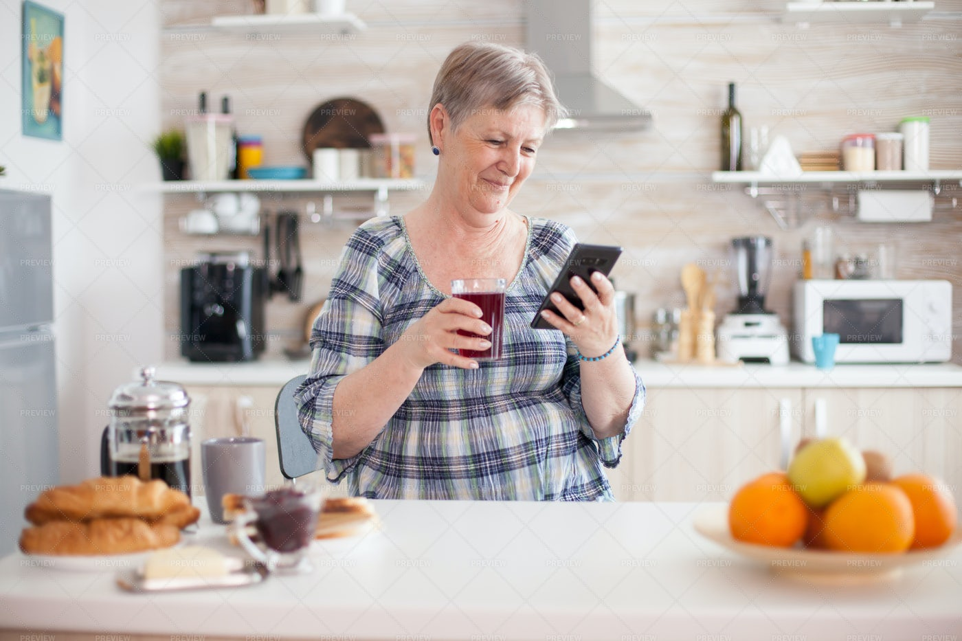 Smiling Older Woman Using Smartphone: Stock Photos