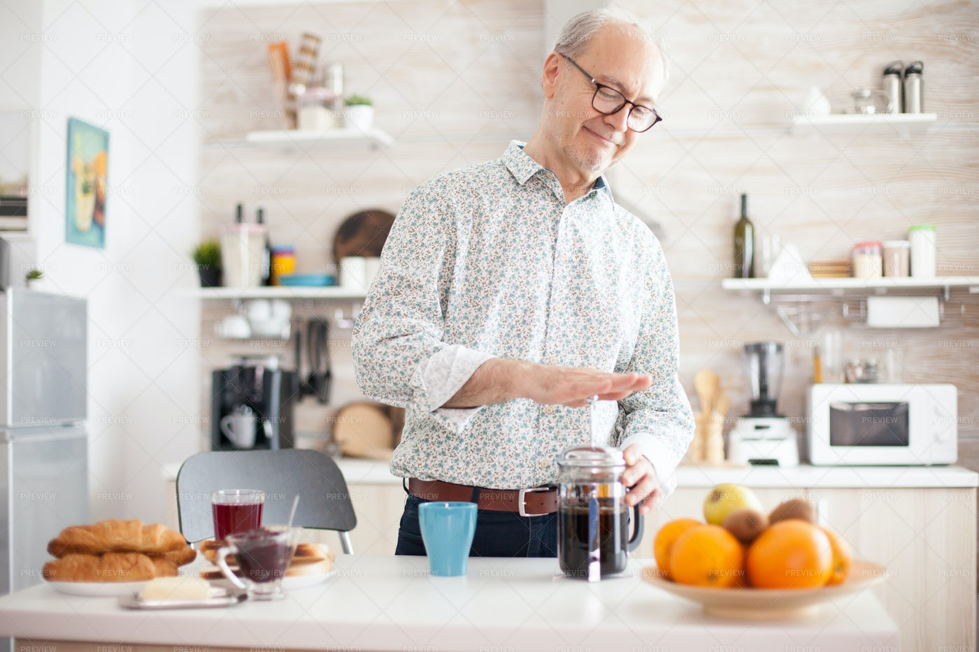 Senior Man Making Coffee: Stock Photos