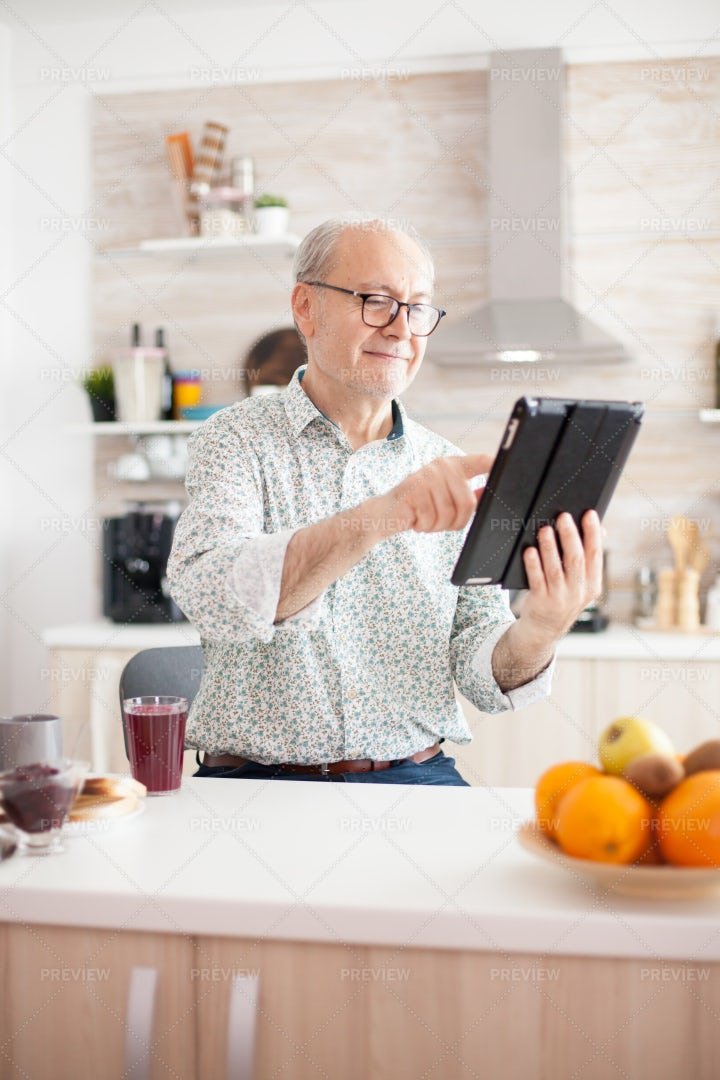 Old Man Holding Tablet: Stock Photos