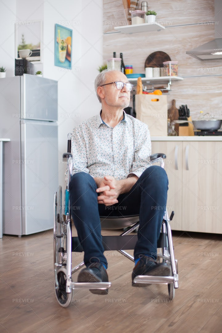 Handicapped Pensioner In Wheelchair: Stock Photos
