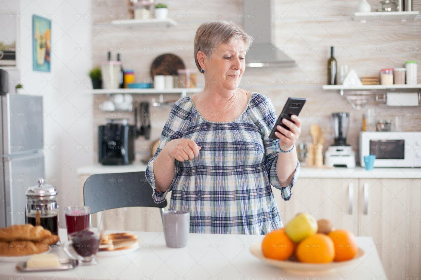 Senior Woman Smiling With Smartphone: Stock Photos