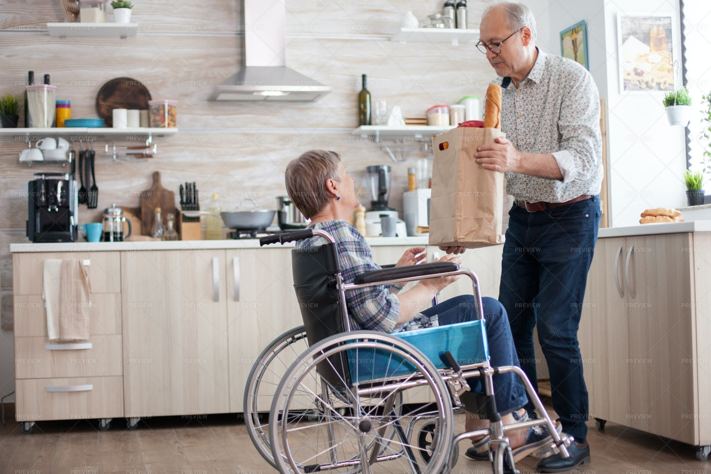 Helping Wife With Groceries: Stock Photos