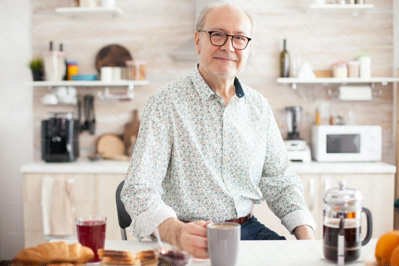Retired Man In Kitchen Portrait: Stock Photos