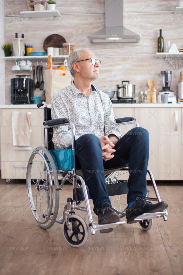 Elderly Man In Wheelchair In Kitchen: Stock Photos