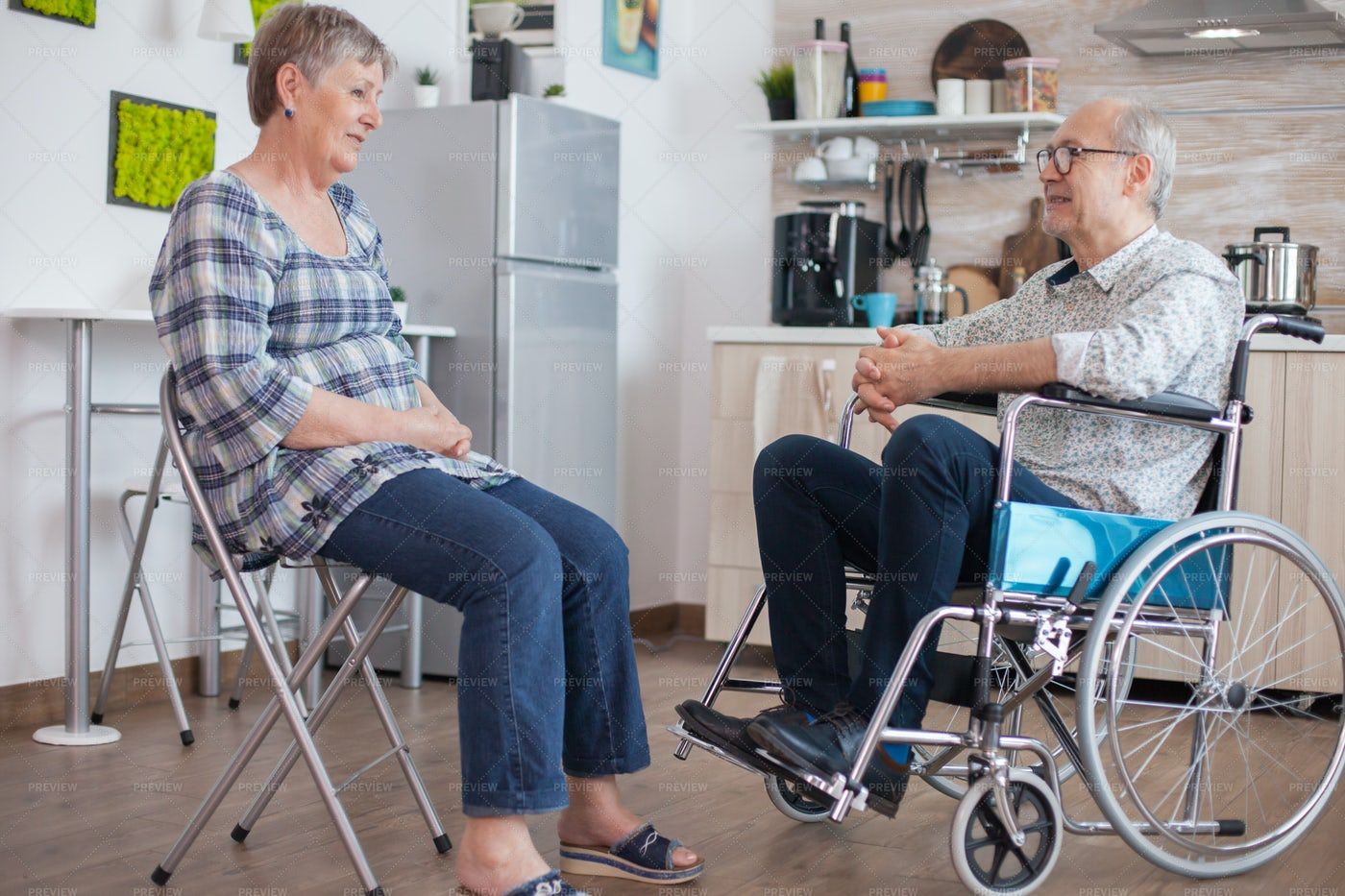 Retired Couple Talking In The Kitchen: Stock Photos