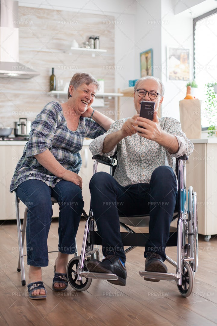 Elderly Couple Laughing And Browsing: Stock Photos