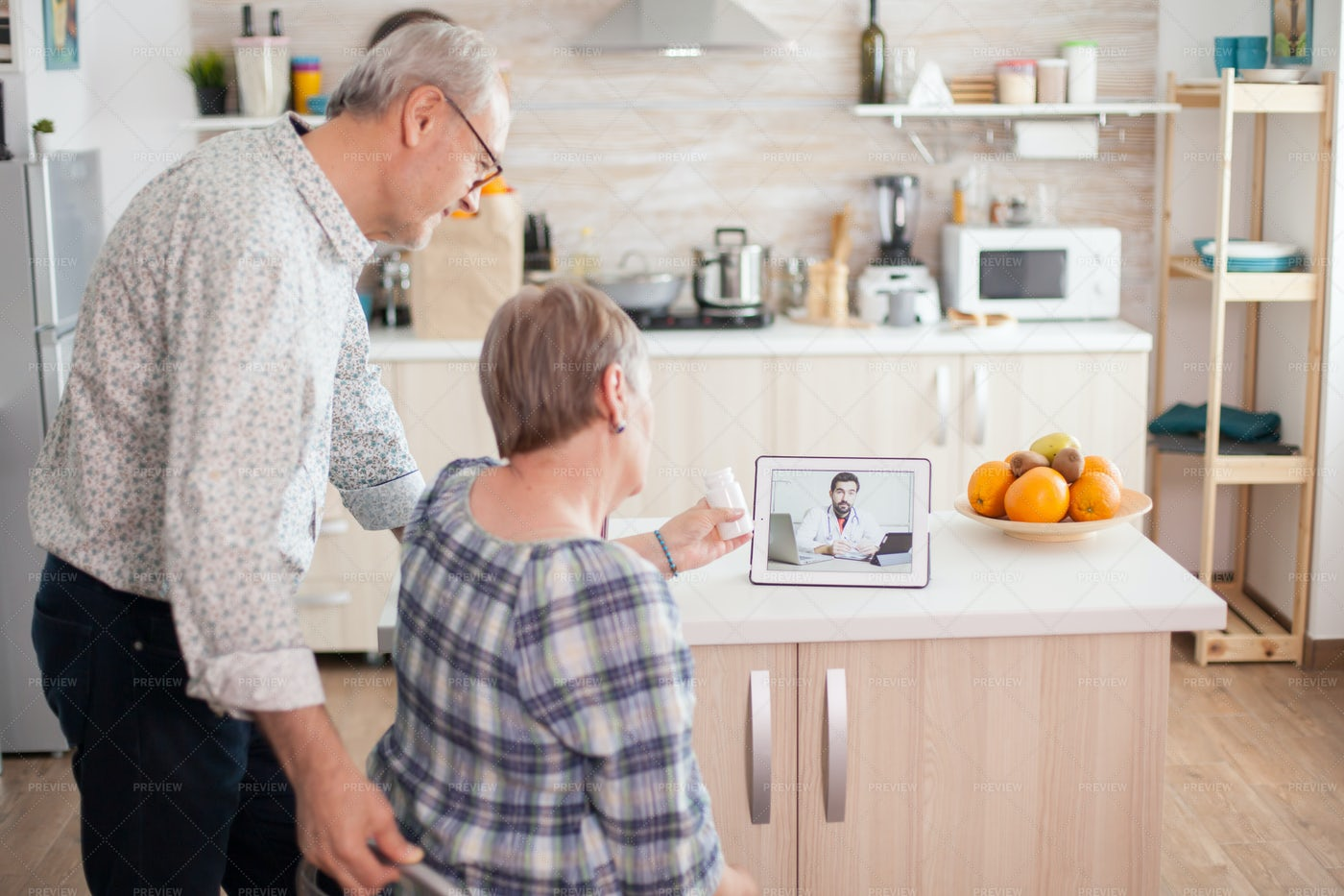 Senior Couple Doctor Visit On Tablet: Stock Photos