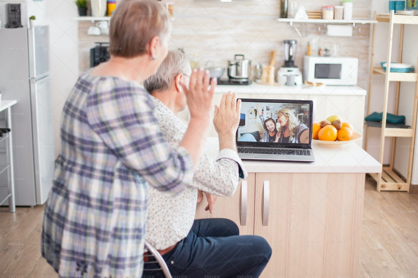 Greeting Family During Video Call: Stock Photos