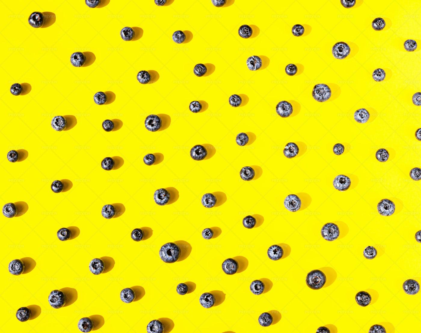 Blueberries Pattern On Yellow: Stock Photos