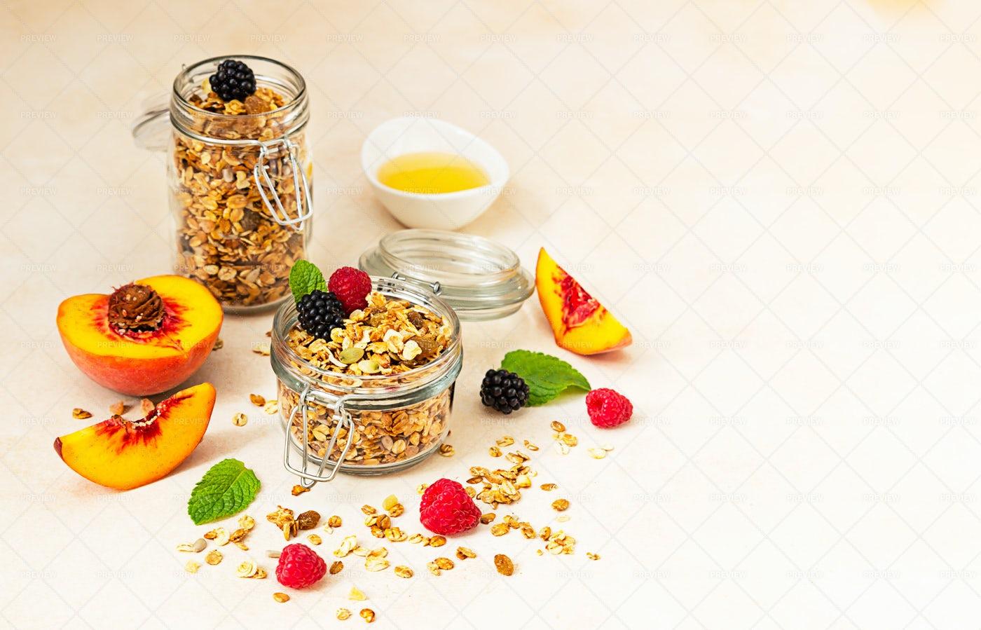 Homemade Granola In Jars Background: Stock Photos