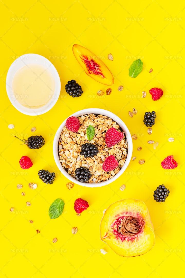 Granola And Berries On Yellow: Stock Photos