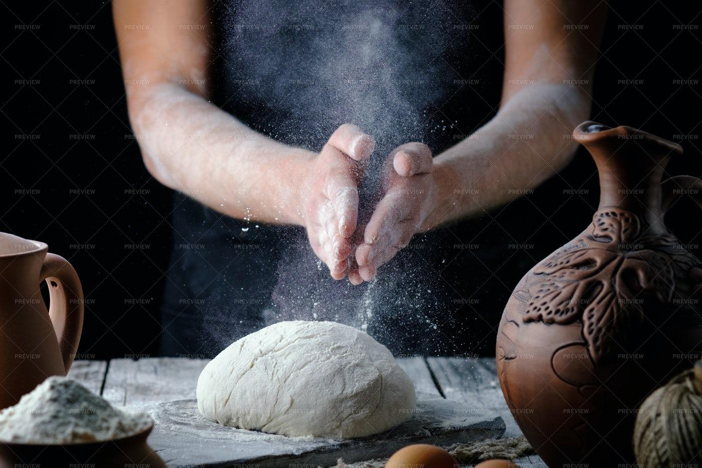 Baker Slapping Flour: Stock Photos