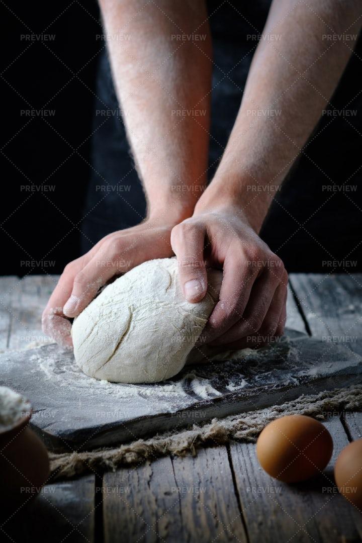 Man Kneads The Dough: Stock Photos