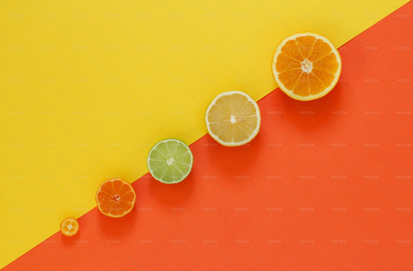 Citrus Fruits On Red And Yellow: Stock Photos