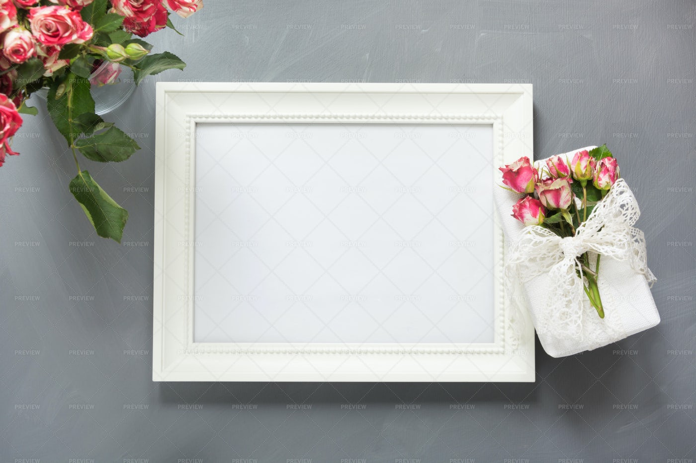 White Photo Frame And Roses Background: Stock Photos