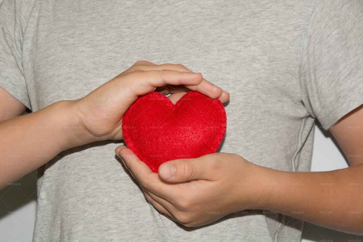 Men Holding A Red Heart: Stock Photos