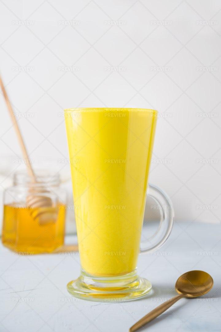 Golden Turmeric Latte And Honey: Stock Photos