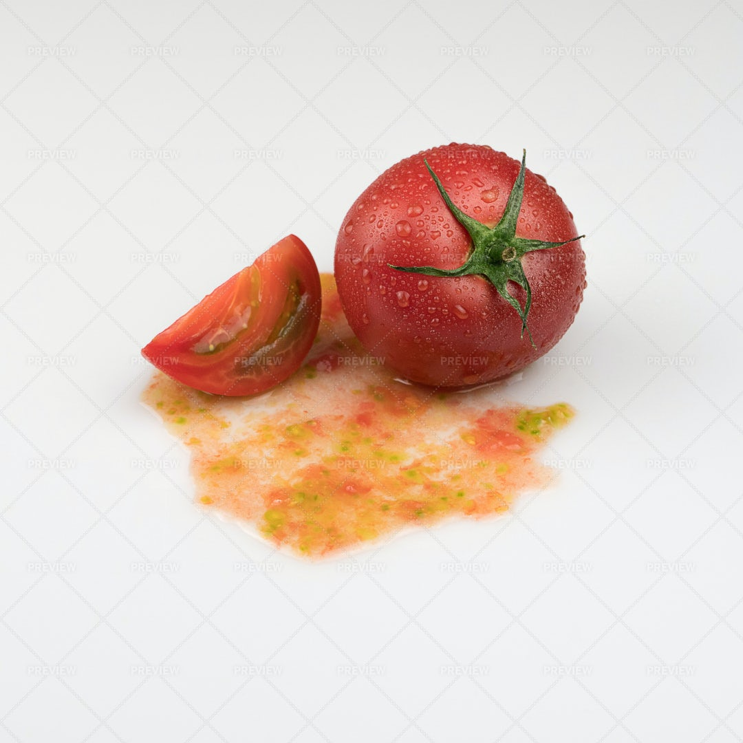 Whole And Sliced Tomatoes: Stock Photos