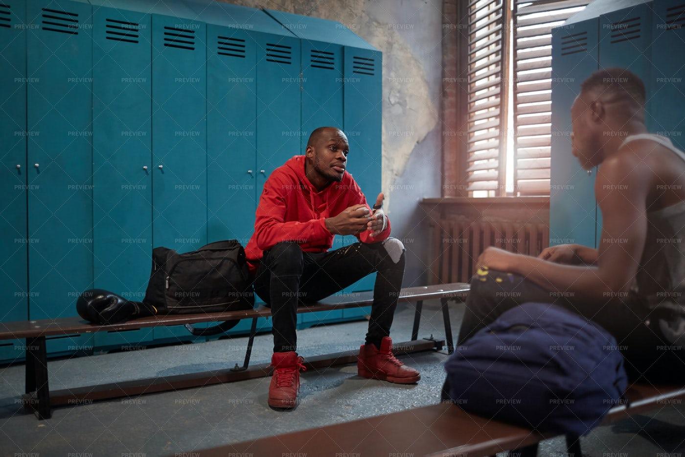 Boxers Talking In Locker Room: Stock Photos