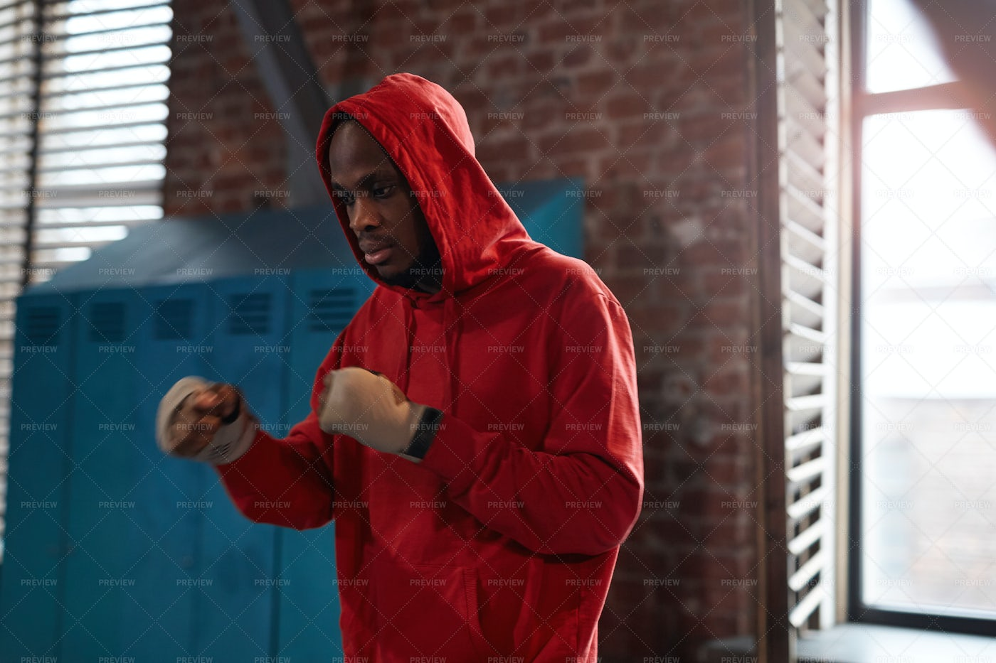 Athlete In Red Hoodie Training In Gym: Stock Photos
