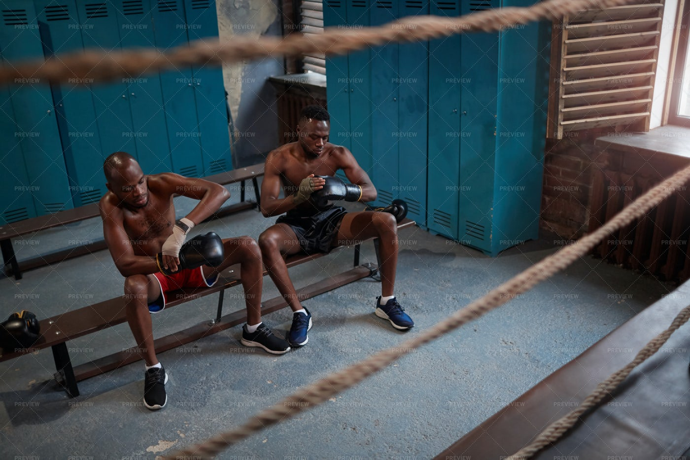 Boxers Putting On Gloves In Gym: Stock Photos
