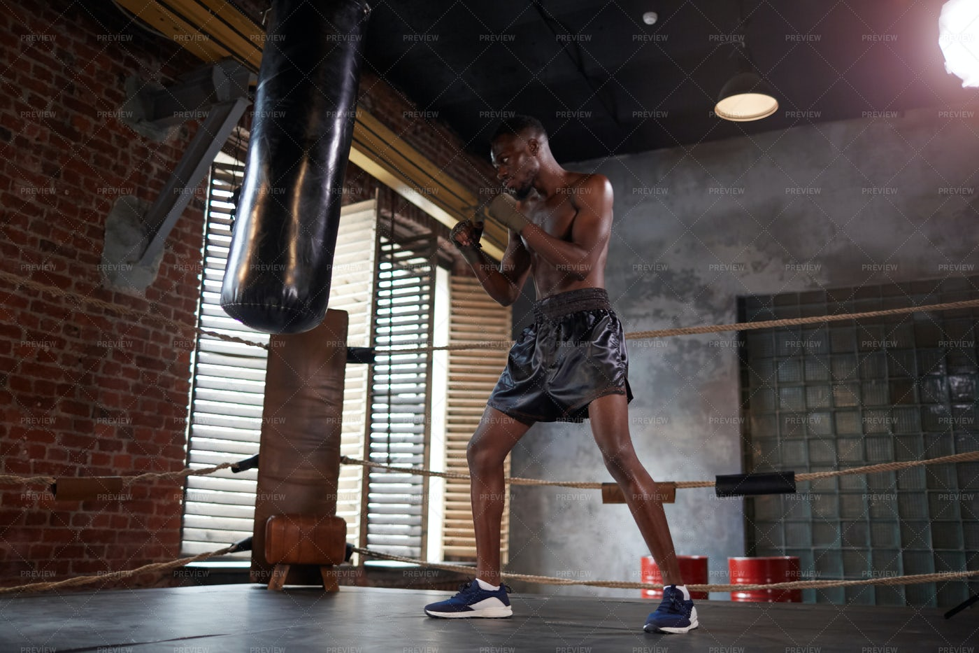 Working Out With Punching Bag: Stock Photos
