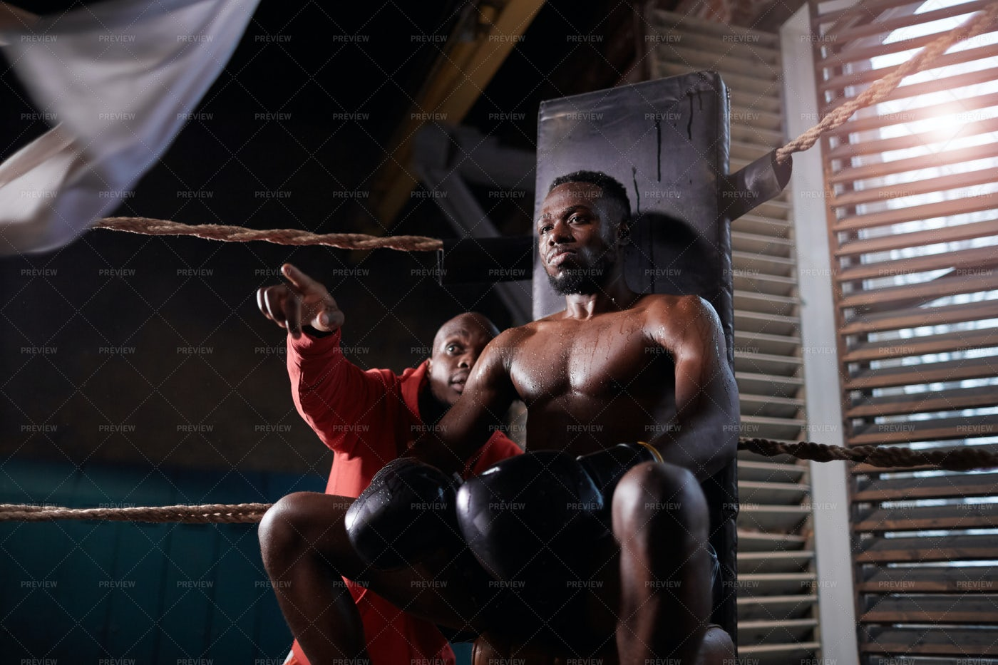 Trainer Talks To Boxer During Bout: Stock Photos