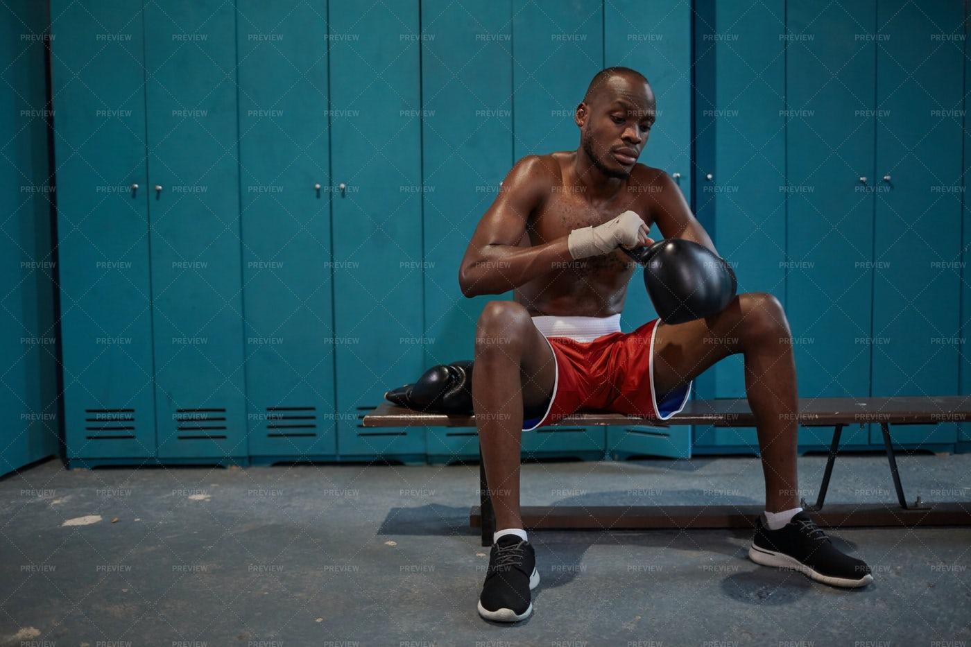 Boxer Sitting In Locker Room: Stock Photos