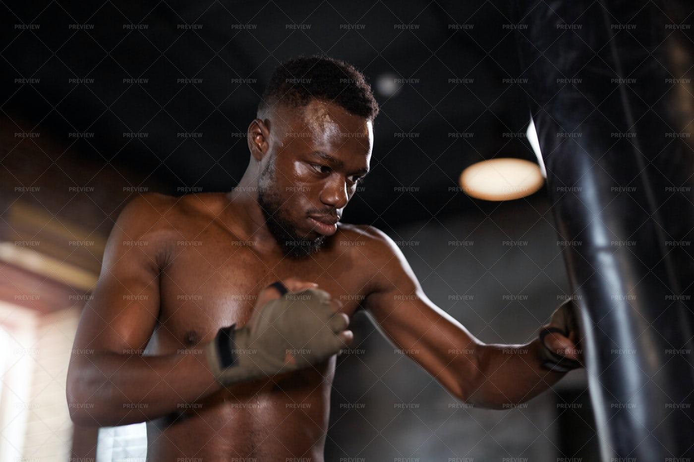 Boxer Punching Bag In Gym: Stock Photos