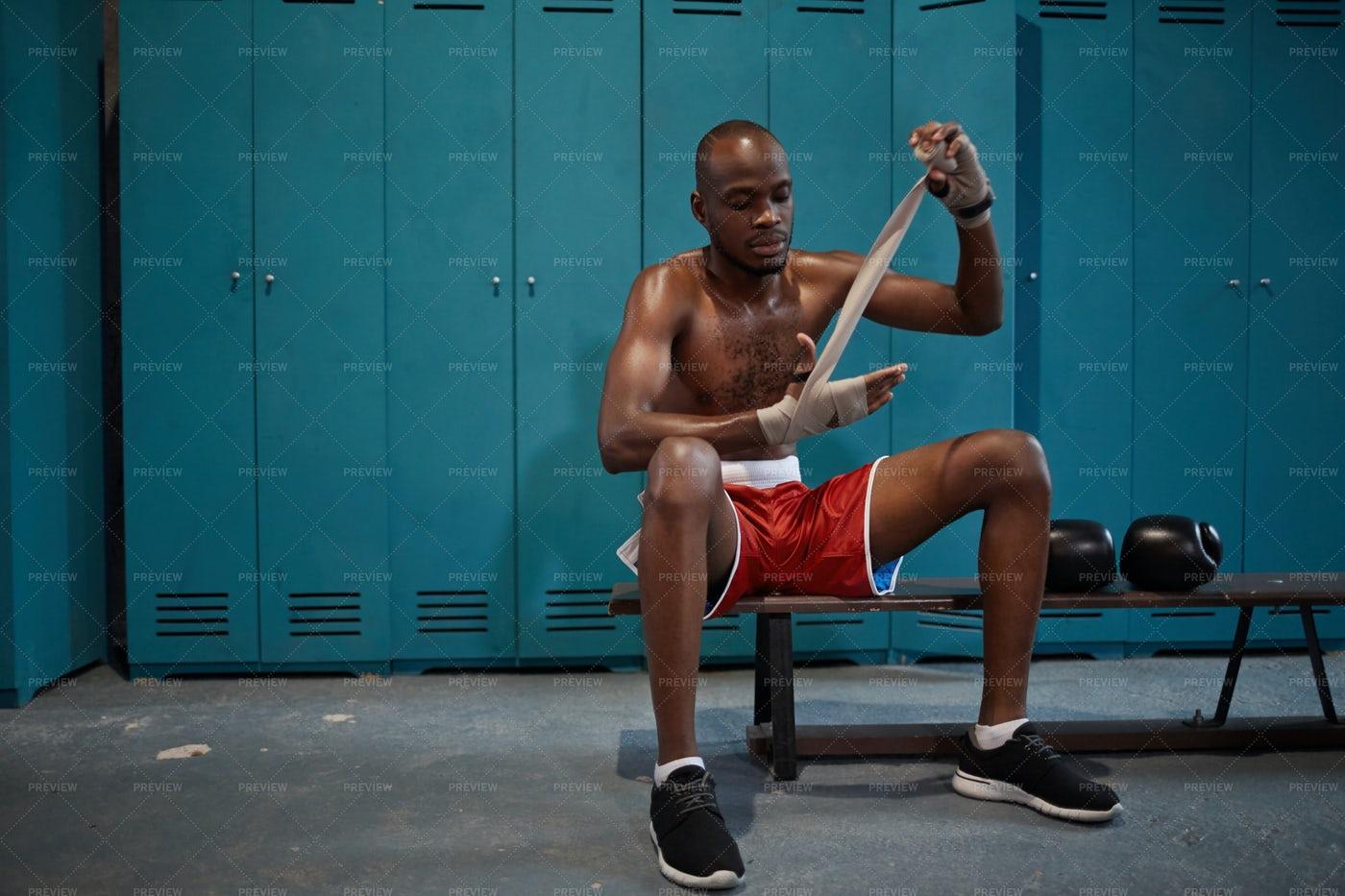 Boxer Wrapping Hands: Stock Photos