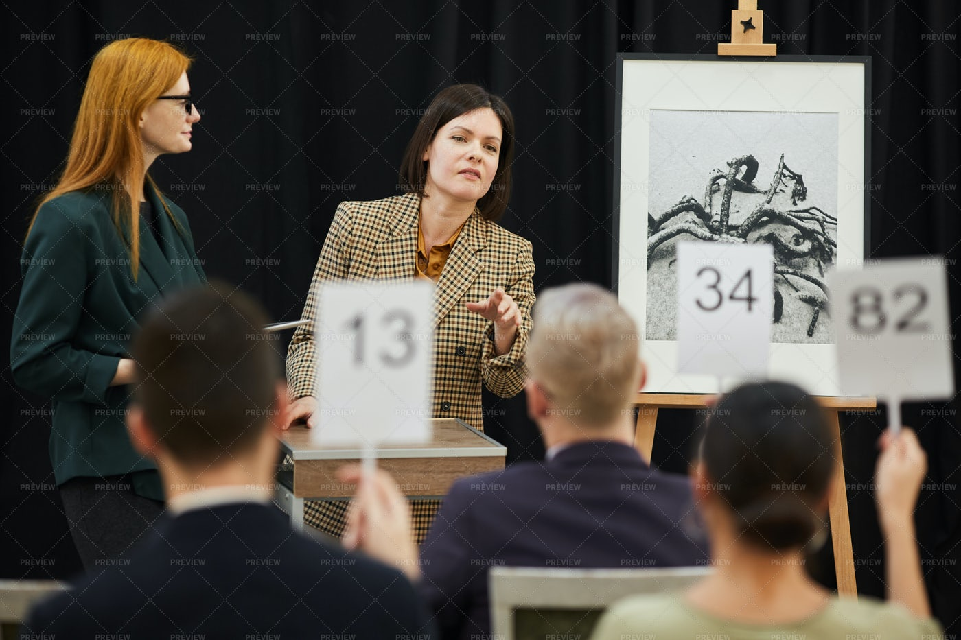 Women Holding An Art Auction: Stock Photos