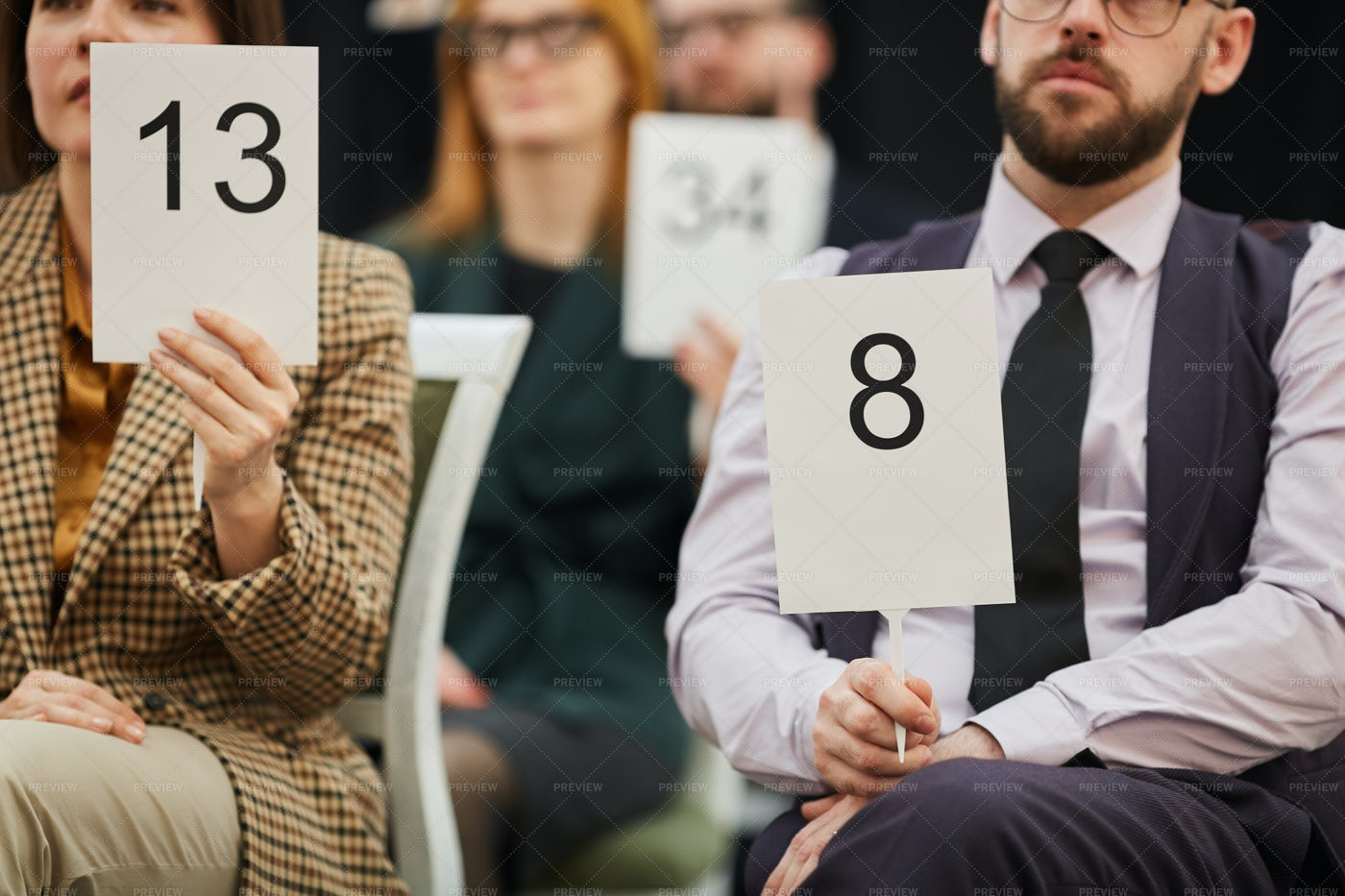 Two People With Auction Signs: Stock Photos