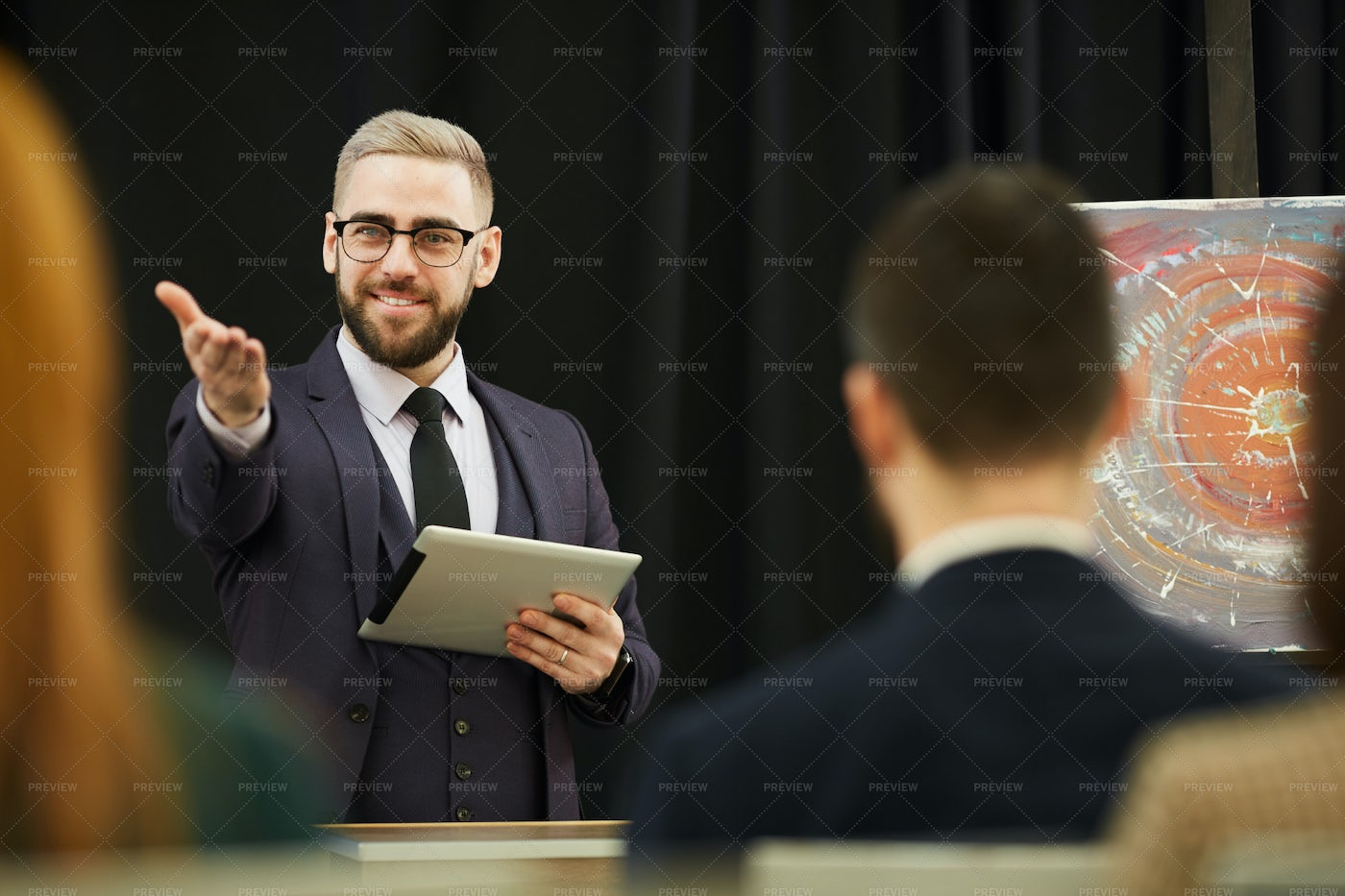 An Auctioneer Signals: Stock Photos