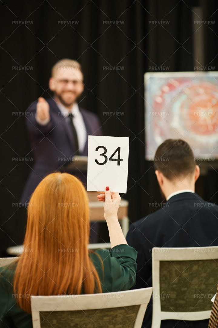 Bidding At An Auction: Stock Photos