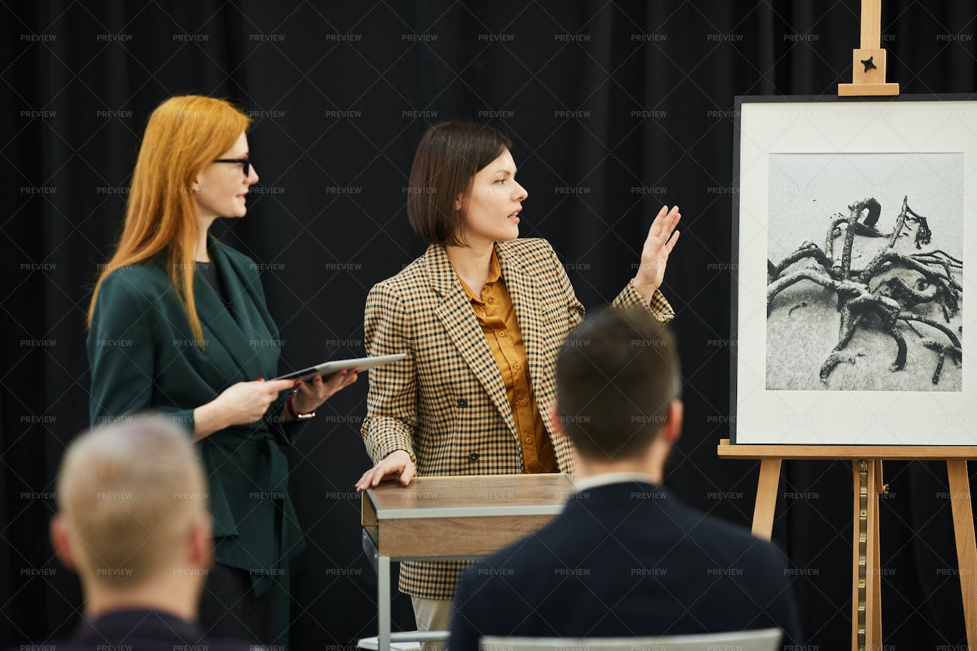 Two Women Presenting The Painting: Stock Photos