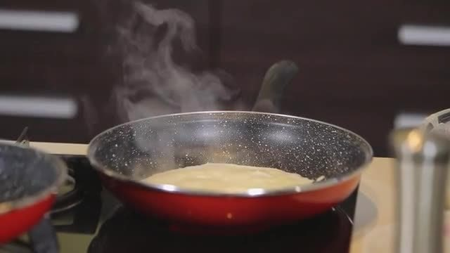 Chef Making A Pancake: Stock Video