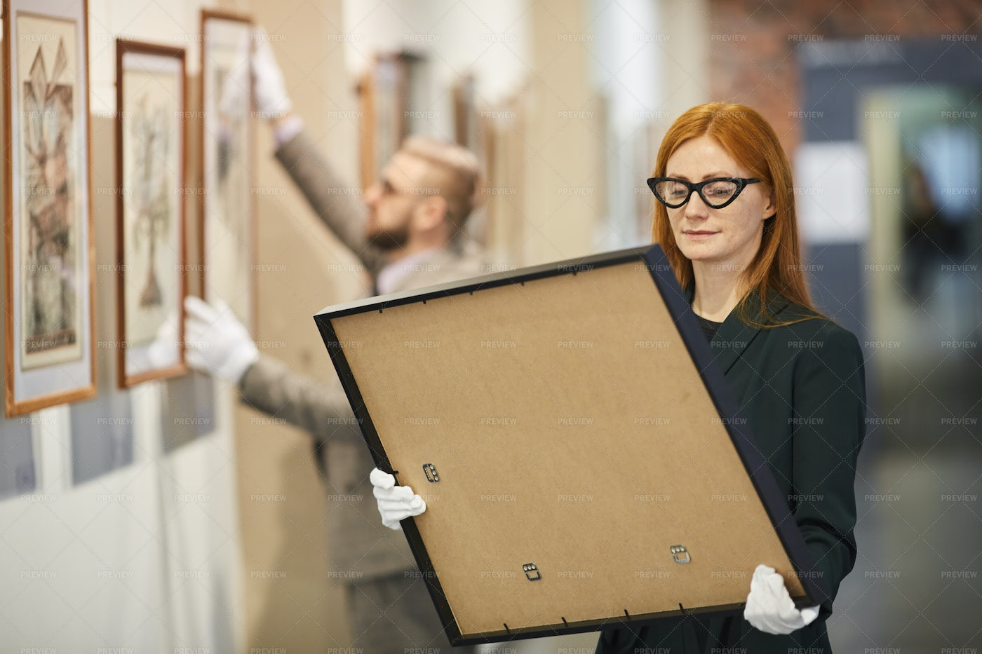 Art Manager Holding A Painting: Stock Photos