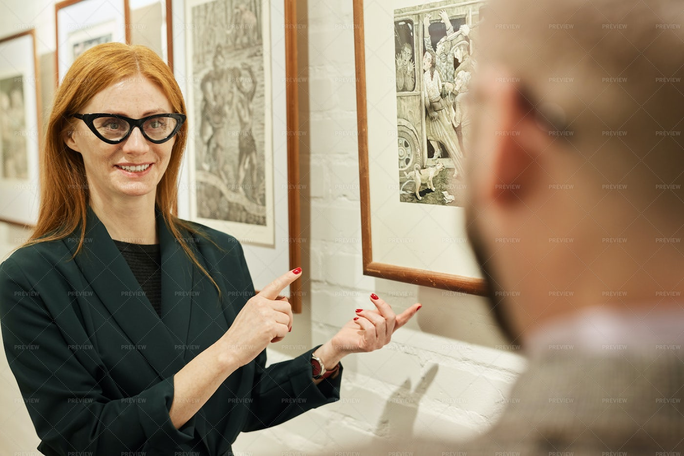 Woman Working At Gallery: Stock Photos