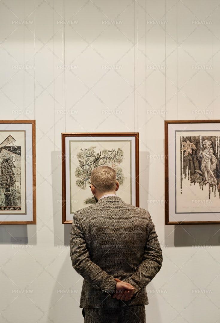 Man Looking At Paintings: Stock Photos