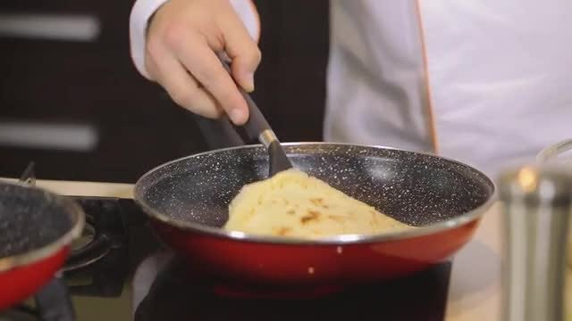 Male Chef Making A Pancake: Stock Video