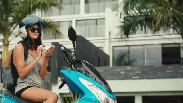 Female Biker Using Map Application : Stock Video